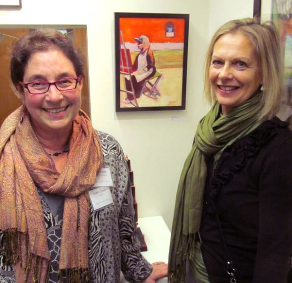 "One favorite moment from the evening - artist and ACA Board Member Gwen Chasan (left) poses with her friend Melanie, who was the model for Gwen's beautiful ""Painting in Provence"" on display, just behind them in the gallery!"