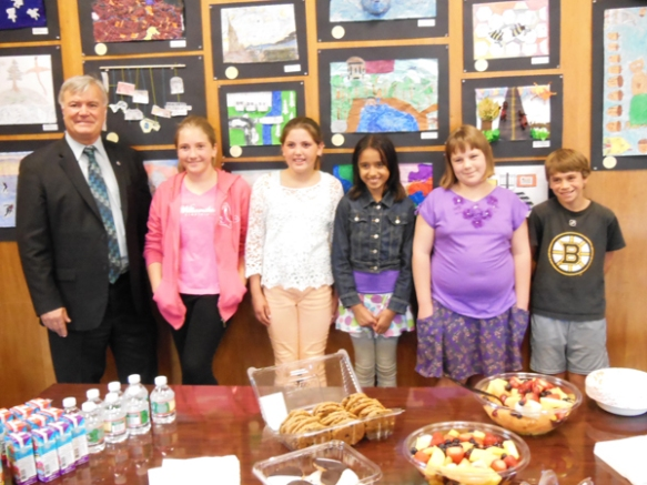 "Several of the 5th grade ""Images of Arlington"" artists posing with Senator Ken Donnelly in a special reception in their honor."
