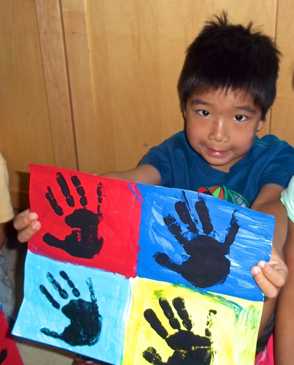 "Our littlest campers, in the ""Young at Art"" group, created charming and colorful hand print pop art paintings."